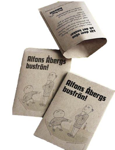 Tre bruna påsar med texten Pappa Åbergs Busfrön som innehåller krasse